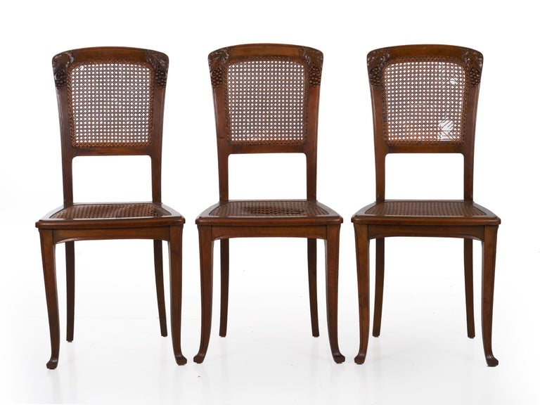 Caning Finely Carved Walnut Set of Six French Art Nouveau Dining Chairs For Sale