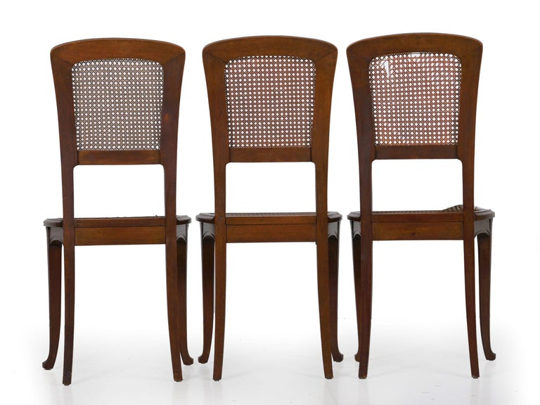 Cane Finely Carved Walnut Set of Six French Art Nouveau Dining Chairs For Sale