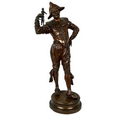 Finely Cast Bronze Jester Holding Doll by G. Gueyton 'French 1841-1919'