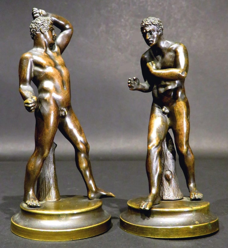 These diminutive classical bronze figures of the mythological boxers Creugas of Durres & Damoxenos of Syracuse, are after the original marble sculptures executed by Antonio Canova (1757-1822), and subsequently purchased by Pope Pius VII in 1802.