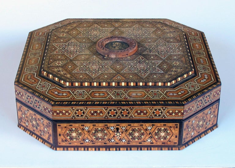 Large size and unusual shape with geometric Moorish design;handcrafted Khatam wooden box withdelicate micro-mosaic marquetryof precious wood and mother of pearl;perfect for a dressing or jewelry box; excellent condition.