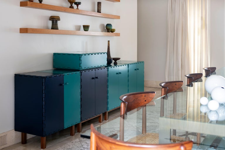 Handcrafted sideboard cabinet in lacquered wood. The lacquer color highlights the simplicity of the design details. The modular quality of the collection allow each cabinet to be combine with other pieces within the collection to create different