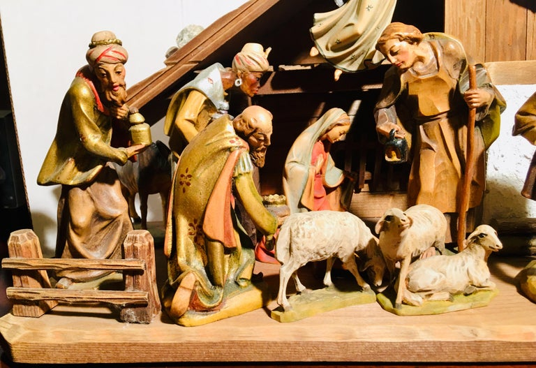 Handmade and hand carved, hand painted, beautifully detailed linden wood nativity scene from the Dementz Family DEUR Art Company in South Tyrol, Italy, is a Christmas decorating focal point. An heirloom to pass down through the