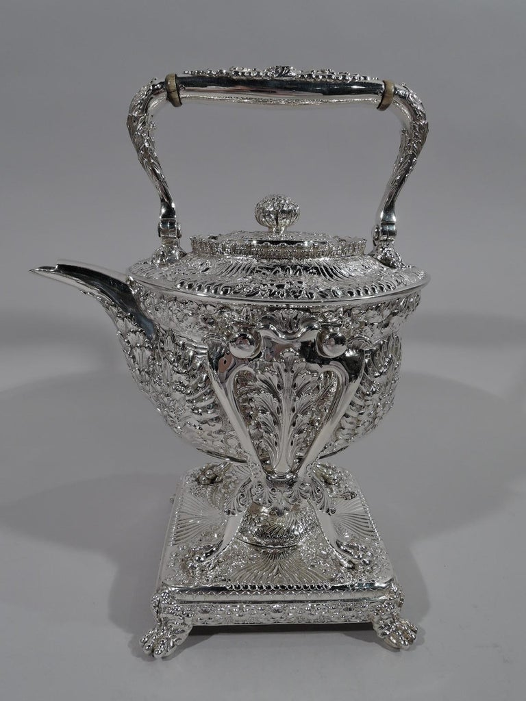 Finest quality repousse sterling silver coffee and tea set. Made by Tiffany & Co. in New York. This set comprises kettle on stand, coffeepot, teapot, hot water pot, creamer, sugar, and waste bowl.  Oval bodies with leaf-capped handles and