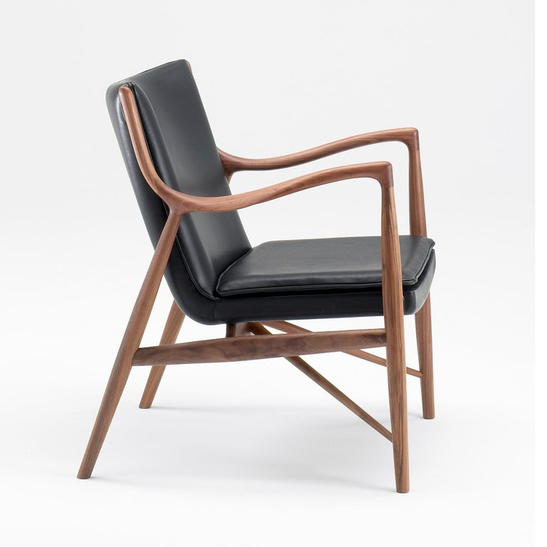 Chair designed by Finn Juhl Manufactured by One collection Finn Juhl (Denmark)  The space between the frame and the seat creates a lightness, which, combined with its organic shape and sublime detailing, creates a unique beauty. The chair is also
