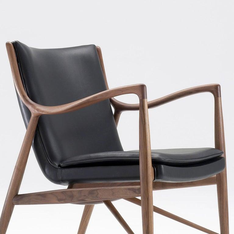 Contemporary Finn Juhl 45 Chair Walnut, Black Leather For Sale