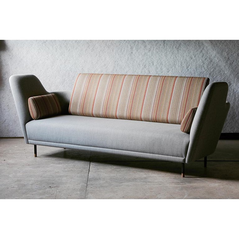 Sofa designed by Finn Juhl in 1957, relaunched in 2000. Manufactured by House of Finn Juhl in Denmark.  The sofa was exhibited for the very first time in the Tivoli Gardens in Copenhagen during 1957. However, it took more than 40 years before