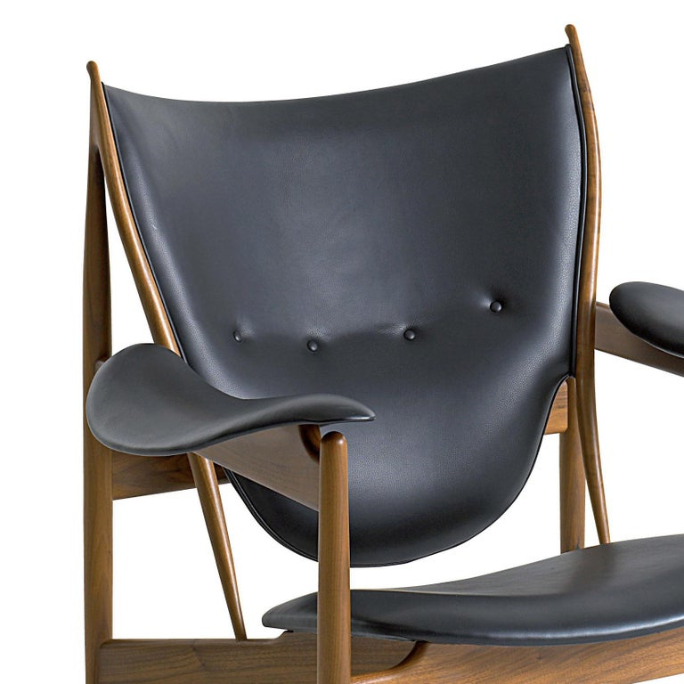 Armchair designed by Finn Juhl Manufactured by One collection Finn Juhl (Denmark)  The iconic Chieftain chair is one of Finn Juhl's absolute masterpieces, representing the peak of his career as a furniture designer. At its introduction in 1949,