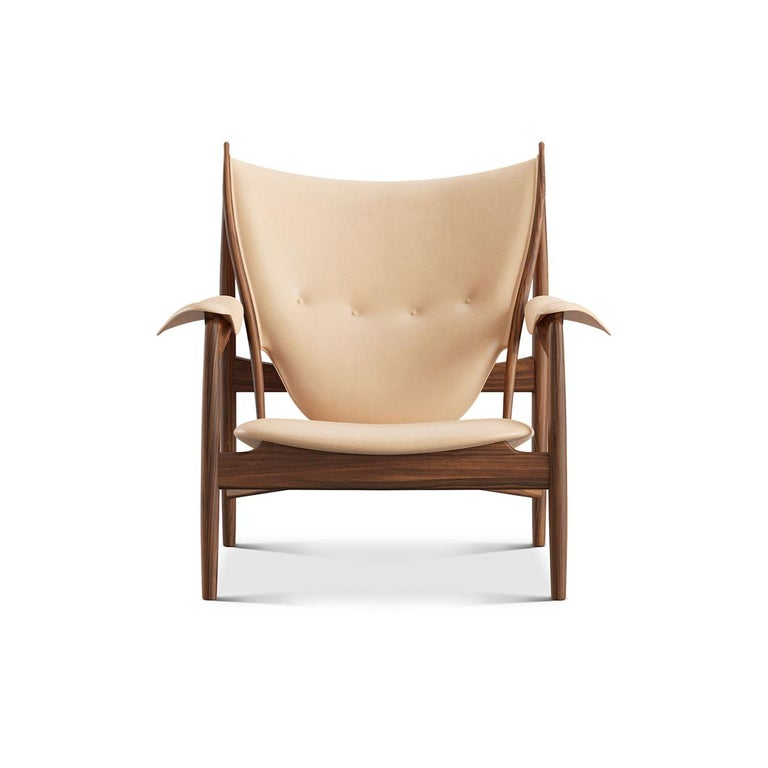 Chair designed by Finn Juhl in 1949, relaunched in 2002. Manufactured by House of Finn Juhl in Denmark.  The iconic Chieftain chair is one of Finn Juhl's absolute masterpieces, representing the peak of his career as a furniture designer. At its