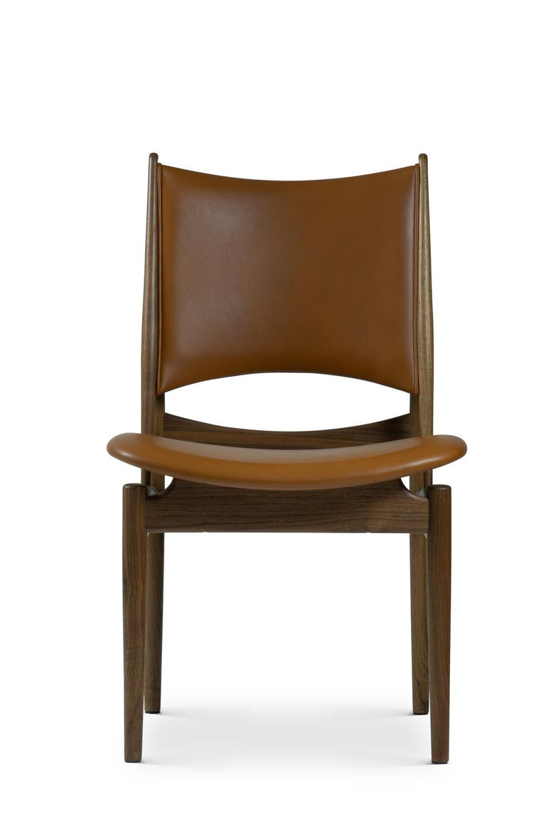 Armchair designed by Finn Juhl in 1949, relaunched in 2014. Manufactured by House of Finn Juhl in Denmark.  Design critics have described Finn Juhl's Egyptian Chair as a miraculous mix of ancient Egyptian design principles, modern rhythms and