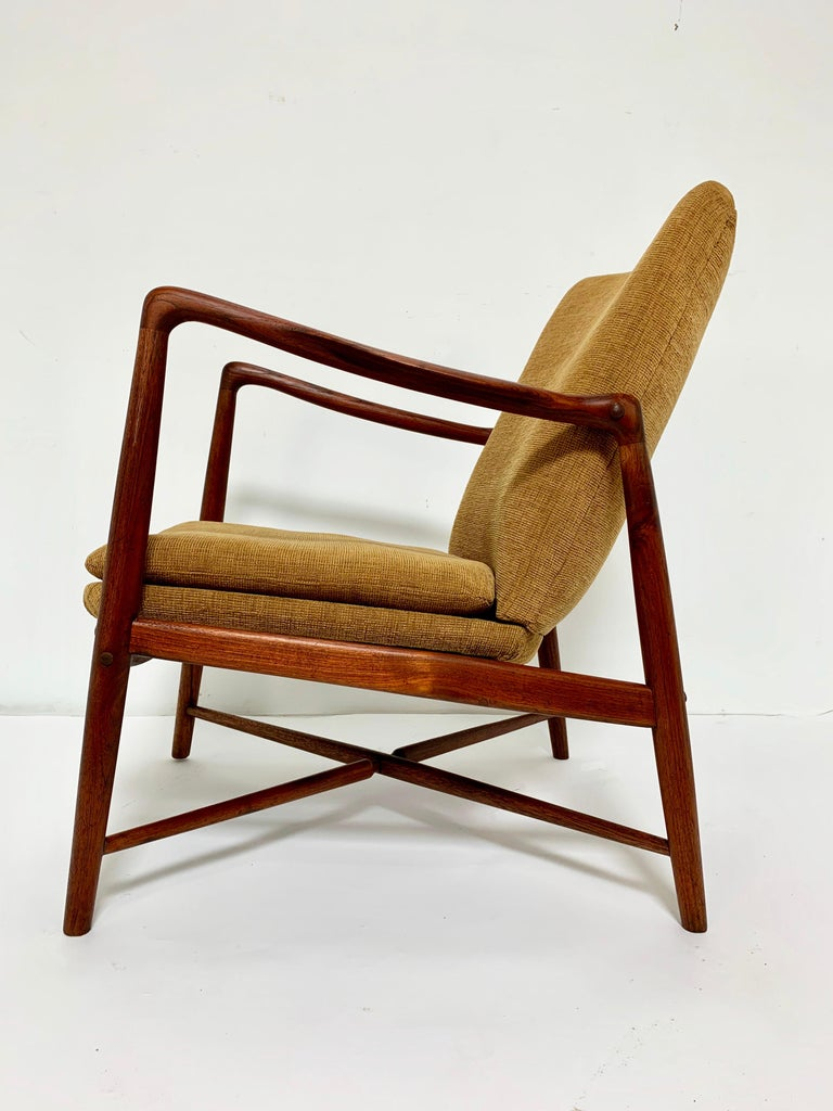 """A """"fireplace chair"""" in teak, model BO59, designed in 1946 by Finn Juhl for Bovirke Furniture of Copenhagen. Only a year prior, his model 45 chair for Niels Vodder had been released to such instant acclaim that Bovirke commissioned this correlative"""