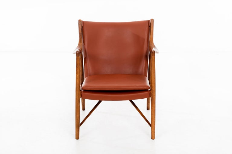 Finn Juhl armchair, model FJ45 Denmark 1945 / USA, circa 1950s Manufactured by Baker Sculpted walnut, fabric upholstery. Originally produced by Niels Vodder, model NV45.