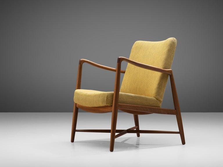 Finn Juhl for Bovirke, armchair model 4443 'Westermanns Kaminstol', teak, fabric, Denmark, design circa 1964, production 1950s  Static armchair designed by Danish designer Finn Juhl and produced by Bovirke. The chair shows the aesthetic