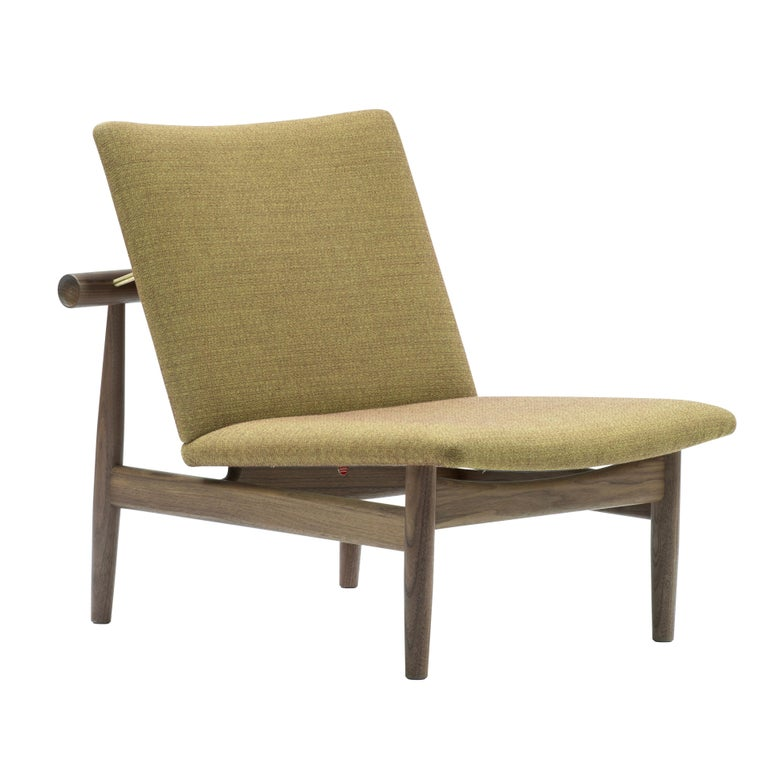Japan chair designed by Finn Jhul Manufactured by One collection Finn Juhl (Denmark)  The Japan Series is produced in oak or walnut with handsewn upholstery in fabric.  1953, relaunched in 2007  Frame: walnut Upholstery: Fabric Kvadrat Foss  Size: W