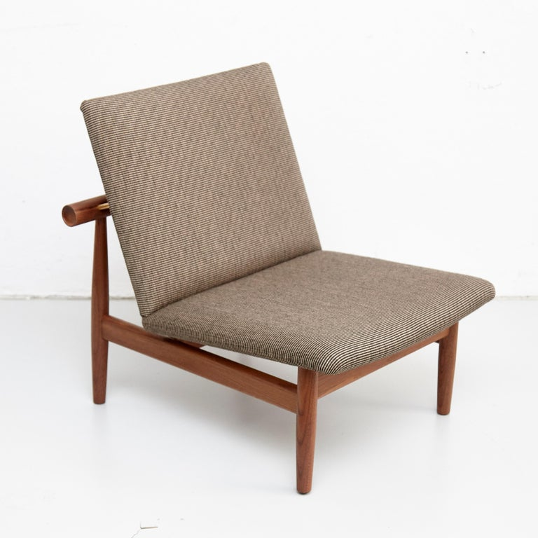Japan chair designed by Finn Juhl Manufactured by One collection Finn Juhl (Denmark)  The Japan Series is produced in oak or walnut with handsewn upholstery in fabric.  1953, relaunched in 2007  Frame: walnut Upholstery:Kvadrat Raf Simons  Size: W