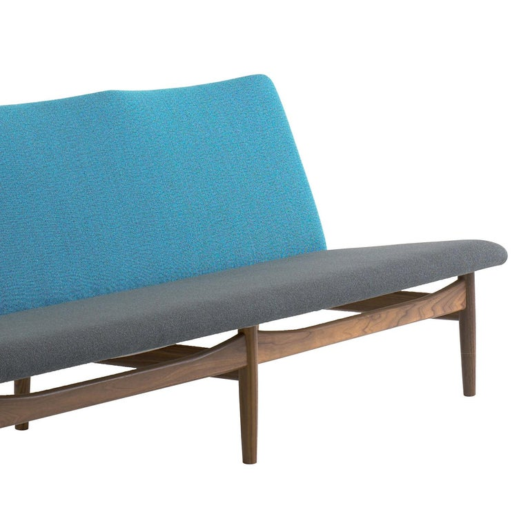 Japan chair designed by Finn Jhul Manufactured by One collection Finn Juhl (Denmark)  The Japan Series is produced in oak or walnut with hand sewn upholstery in fabric.  1953, relaunched in 2007  Frame: Walnut Upholstery: Discontinued