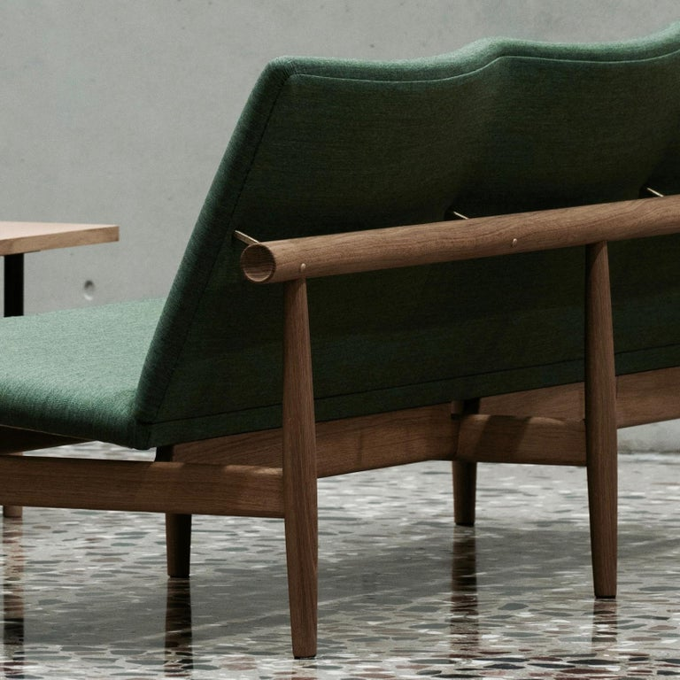 Japan chair designed by Finn Jhul Manufactured by One collection Finn Juhl (Denmark)  The Japan Series is produced in oak or walnut with handsewn upholstery in fabric.  1953, relaunched in 2007  Frame: Walnut Upholstery: Fabric Kvadrat
