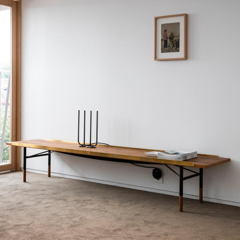 Table bench designed by Finn Juhl in 1953, relaunched in 2012. Manufactured by House of Finn Juhl in Denmark.  Finn Juhl experienced an international breakthrough in the USA during the early 1950s. He subsequently designed a range of furniture