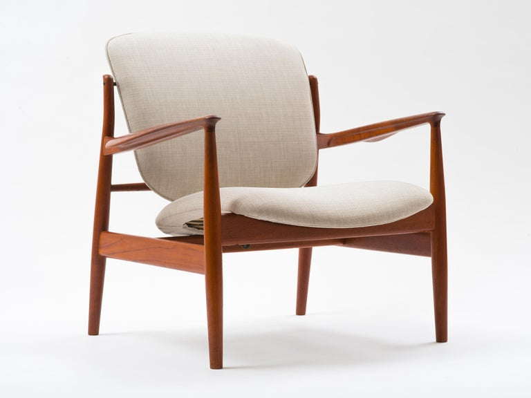 Lounge chair model number FD 136 designed by Finn Juhl for France & Son, Denmark. Curved backrest and an undulating seat that appears to float as a cloud within the spare, elegant frame. This chair belonged to a Danish expat here in New York who was