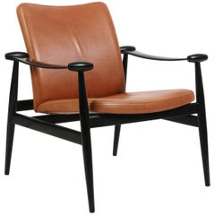 Finn Juhl Lounge Chair, Spade Stolen FD133, Black Lacquered and Cognac Leather