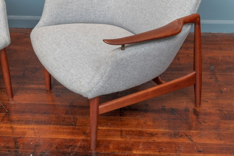 Finn Juhl design NV-53 teak lounge chairs, stamped Niels Vodder, Denmark. Matched original pair of chairs from the original owner newly refinished and upholstered in Danish wool.  Both chairs are branded with manufacturer's mark, elegant and comfy