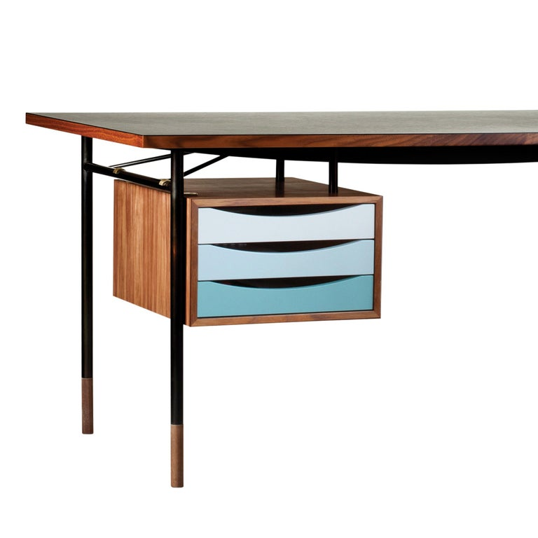 Desk designed by Finn Jhul Manufactured by One collection Finn Juhl (Denmark)  When Finn Juhl established his first studio at the exclusive address of 33 Nyhavn in central Copenhagen in 1945, he designed a very simple desk with burnished steel
