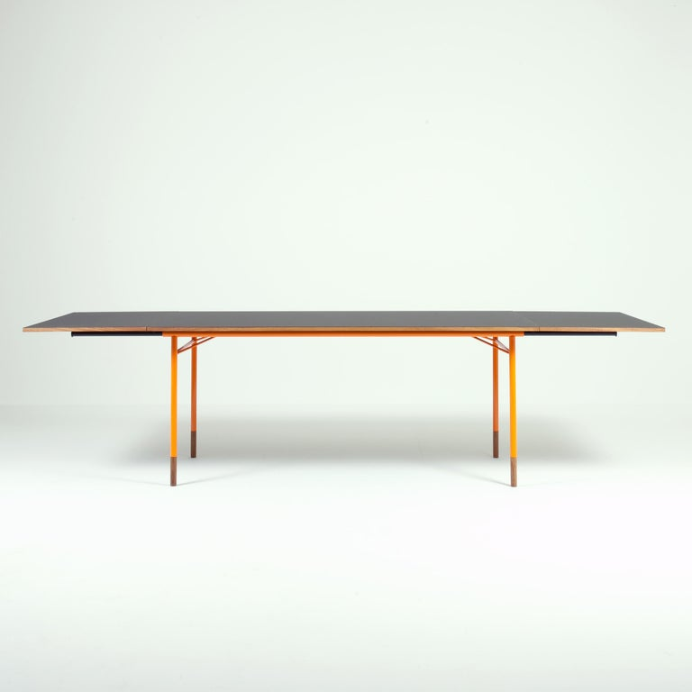 Desk model Nyhavn designed by Finn Jhul Manufactured by One collection Finn Juhl (Denmark) Orange lacquered metal, walnut wood, black linoleum top.  Several of Finn Juhl's simple and beautiful designs from the 1950s are combined with color