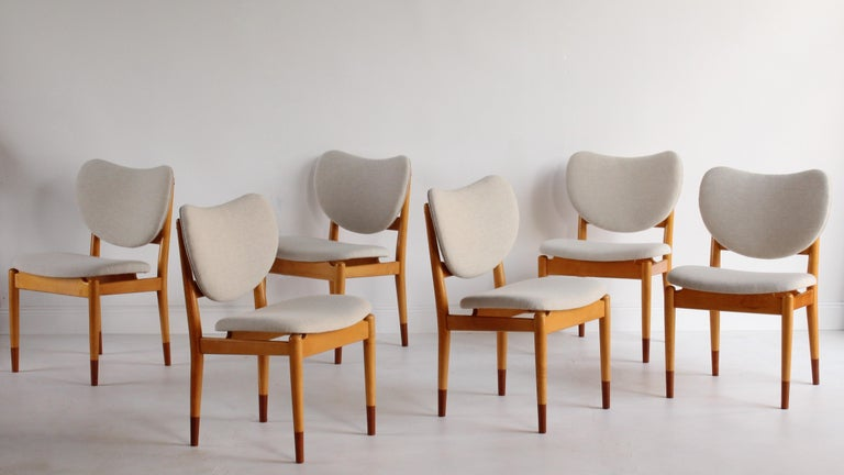 A rare dining group of six dining / side chairs designed by Finn Juhl and produced by Søren Willadsen Møbelfabrik. Executed in maple frames with teak feet, and upholstered in a light beige, high-end, Danish fabric.   This rare design by Finn Juhl