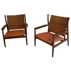Finn Juhl Rare Pair of NV55 Armchairs in Teak and Cane for Niels Vodder, 1955