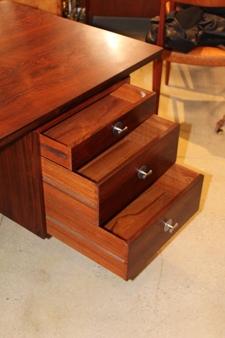 Stunning 1960s Danish rosewood technocrat executive desk designed by Finn Juhl for France & Son. with 5 drawers and chrome hardware.