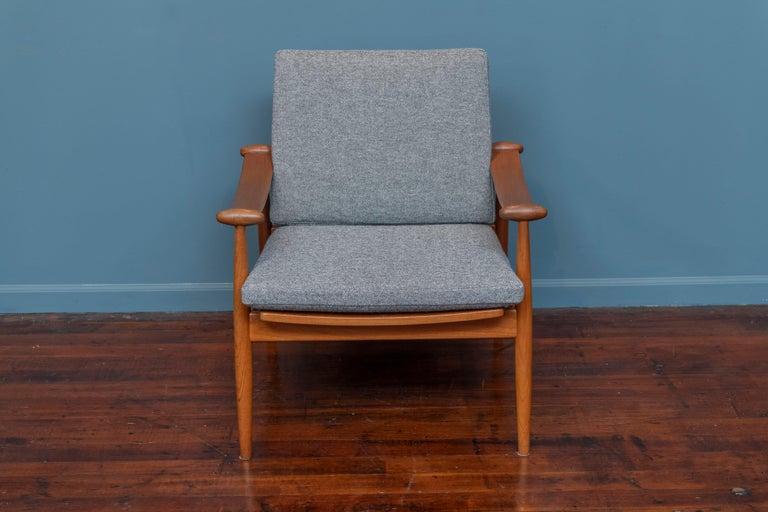 Finn Juhl design spade chair model 133 for France & Daverkosen, Denmark. Newly refinished teak frame with new cushions upholstered in Danish wool.
