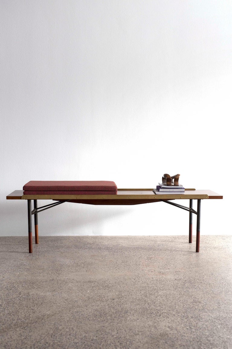 Finn Juhl table bench in teak with foldable fabric cushion. 