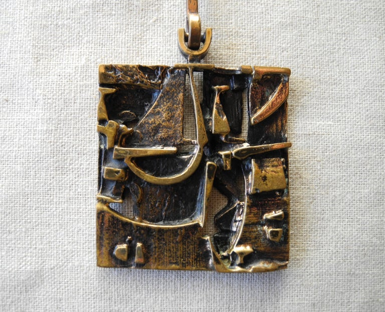 This modernist bronze pendant with original chain was produced in the 1960s in Finland by Jorma Laine.