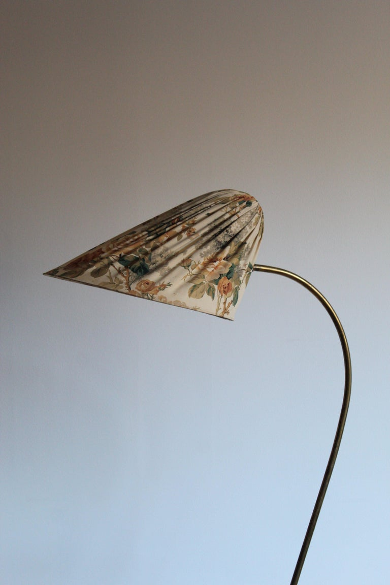 An organic curved floor lamp. In brass with it's original floral fabric screen. By unknown Finnish designer.
