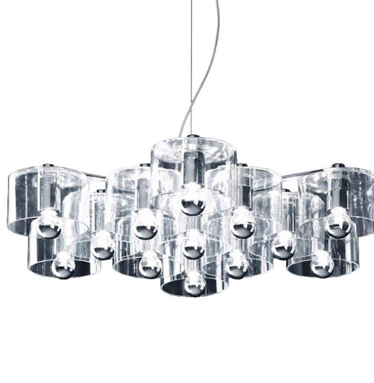 Fiore suspension lamp designed by Marta Laudani & Marco Romanelli for Oluce. The lamp consists of clear glass cylinders that connect to a metal body creating a shape that resembles a stylized flower. Metal and blown glass are the materials used in