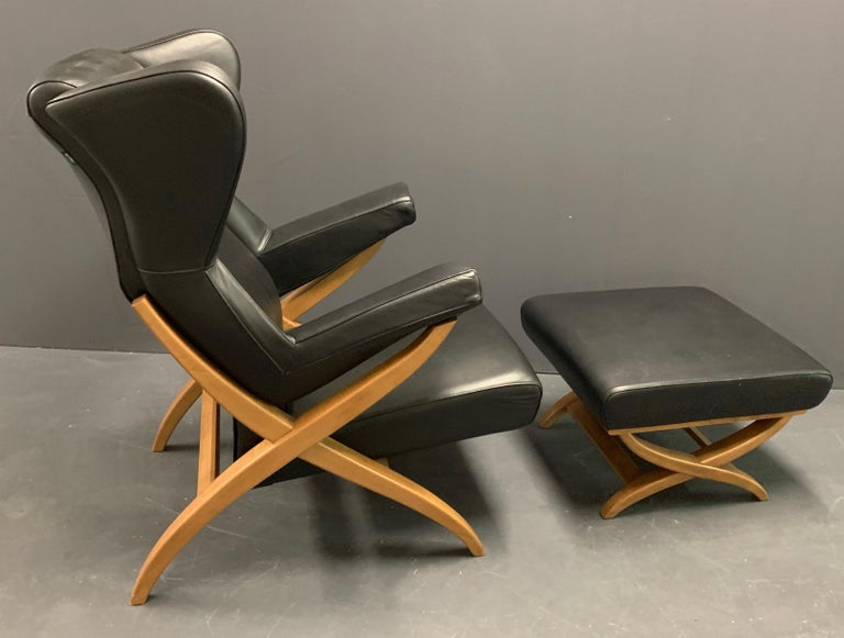Showroom model in wonderful condition. Black leather. Recent production of a design from 1952.