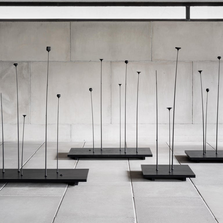 The Fiori sculpture composes of slender-stemmed wooden flowers, which variously grouped, capture the moment of calm and freedom sometimes experienced in nature. Each flower is handcrafted using a variety of techniques. The sculpture can perform many