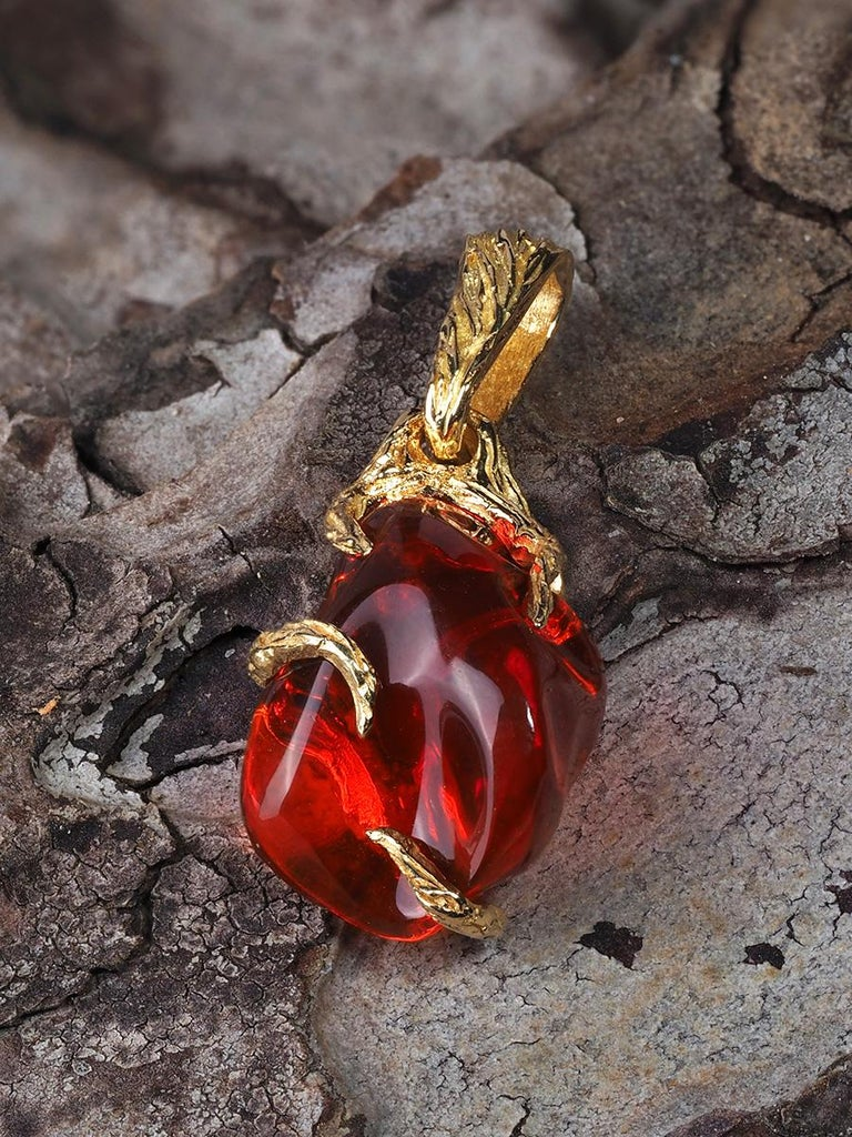 18K yellow gold pendant with natural fire opal  opal origin - Mexico  stone measurements - 0.39 x 0.59 in / 10 х 15 mm  gemstone weight - 2.78 carats  pendant height - 0.94 in / 24 mm  pendant weight - 1.66 grams  Roots collection