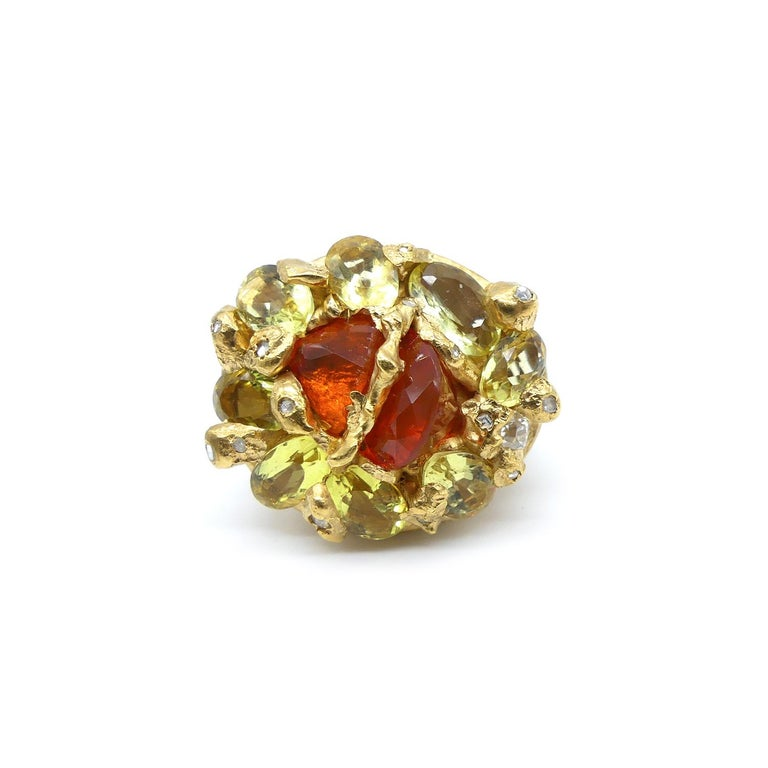 Fire Opal Citrines Diamonds Gold Plated Cocktail Ring  Fire Opal divided in two with 0'32 Carat Diamonds in a Gold Plated Cocktail Ring.  This ring is from the Collection