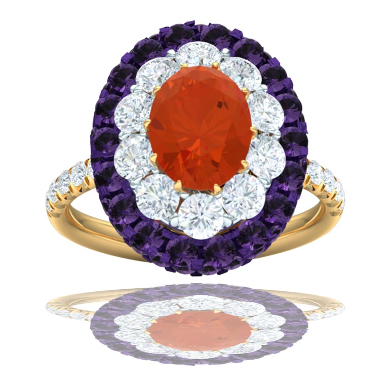 A cherry red-orange Fire Opal is centered in this ring and weighs 1.3 carats.  The color is a top grade red orange vivid color and VS clarity, extremely rare for this gemstone.  The center is surrounded by 10 round brilliant diamonds which have a