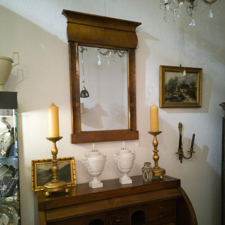 Fireplace mirror Biedermeier circa 1840 nut shellac  Puristically held mirror with a frame made of walnut burl wood veneer. The from does without obtrusive elements such as carvings or columns, a clear language of form was the spirit of the time.