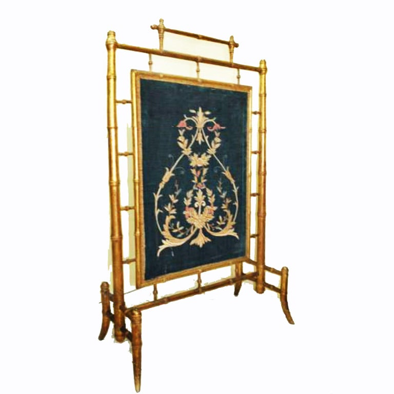 Firescreen wooden gilded in the form of bamboo and with gold leaf and hand-embroidered velvet with gold thread  Chippendale chinoiserie style  19th century, England origin