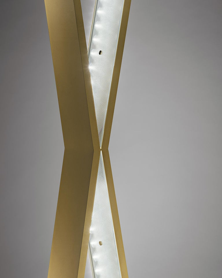 Please note that VAT is not included in the price.  A willowy brass X of which inner sides contain 12 LEDS, covered by sophisticated diamond cut glasses. Able to function as either a floor lamp or a suspension lamp, it has generous dimensions and
