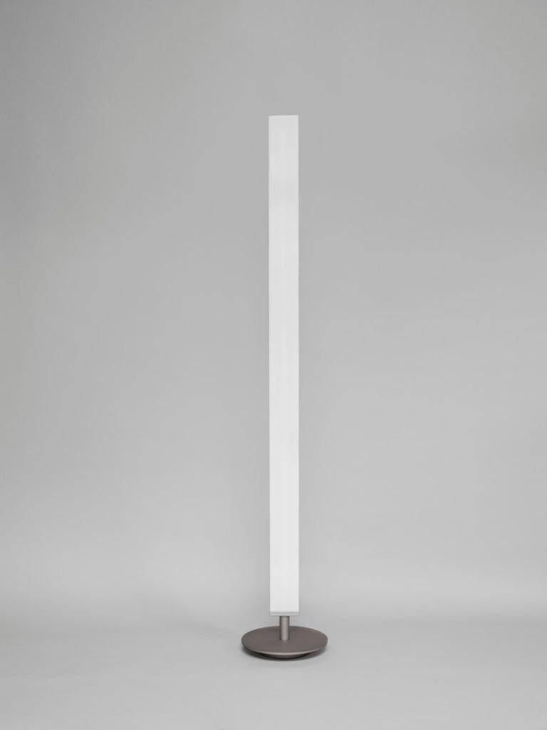 Please note that VAT is not included in the price.  Floor lamp with methacrylate diffuser to give a warm spread light through two sources of light. One indirect light and one diffused light. Simple, elegant, functional, instantly recognizable for