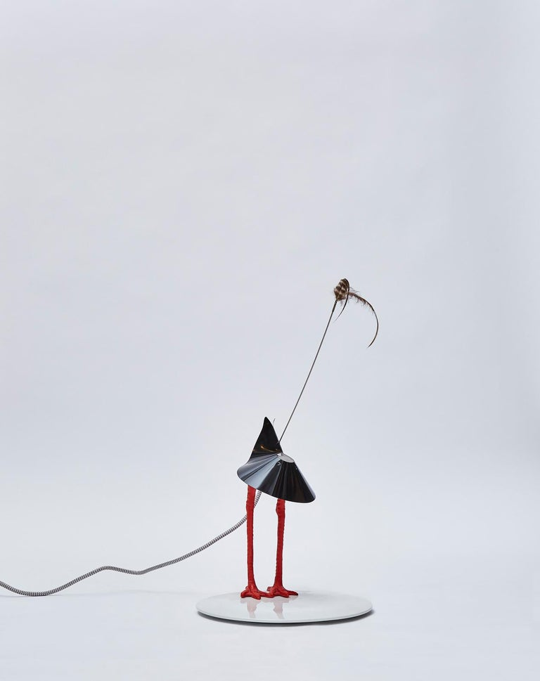 Creative lamp by Ingo Maurer, the Bibibibi, number 2 out of 500 of the first edition.  Originally designed as a wedding gift made with some legs from a plastic stork, which he had seen at a supermarket, the playful new table lamp was very well