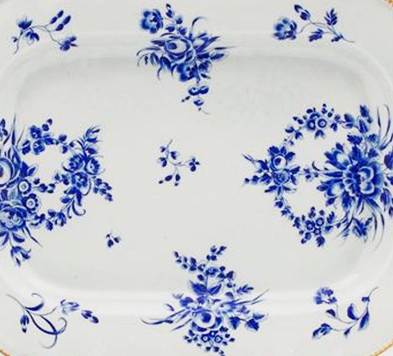 First Period Worcester dry blue enamel large dish or platter, (Dr. Wall), circa 1768-1970.  The large First Period Worcester porcelain dish with canted corners is painted with flowers in dry blue.  John Sandon mentions that blue enamel was a