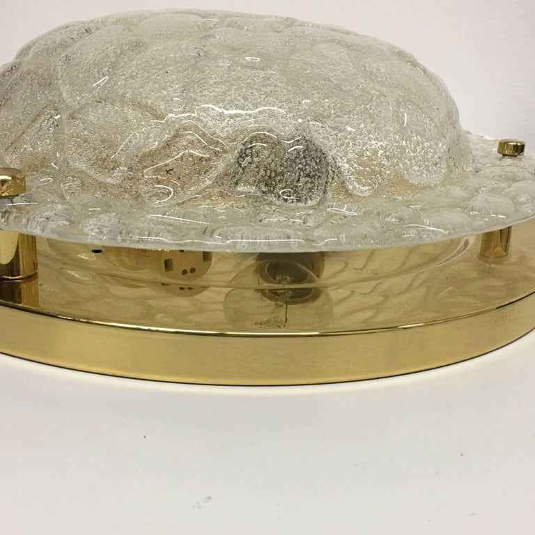 Exquisite mid century flush mount by Fischer Leuchten of Germany. This stunning piece is made of thick textured glass and requires three E27 Edison bulbs up to 60 watts. Item will be shipped directly from Germany to buyer.