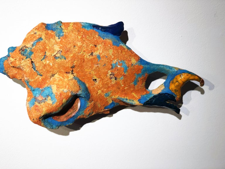This fish sculpture by German artist Diana Hartung is created from sculpted paper-clay, a mixture of paper pulp and clay material which gives the work a beautiful textured organic surface. This matte surface is interspersed with glazed fired clay