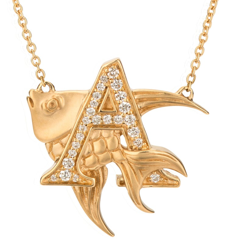 Uncover the mystery and magic of aquatic life with our 'A is for Angelfish' necklace. Crafted in 18 karat yellow gold and set with white diamonds this piece boasts an intricate matt finish angelfish intertwined within the letter A on a 42cm gold