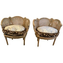 Fit for a Princess Pair of Louis XVI Painted Carved Wood and Double Caned Chairs